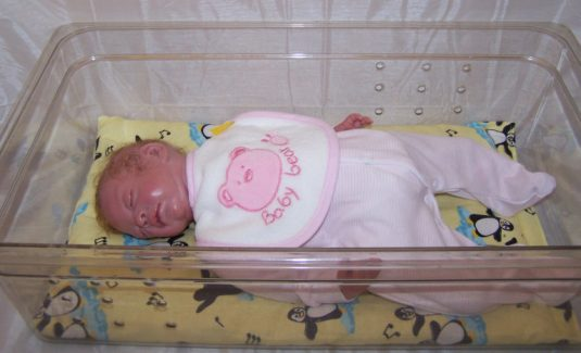 premature baby clothes on a Reborn baby doll